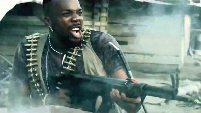 A Soldier's Story production still: Sambasa Nzeribe shooting machine gun
