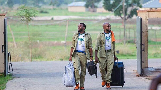 Up North production-still: banky-w and ibrahim suleiman arrives at NYSC camp ground.
